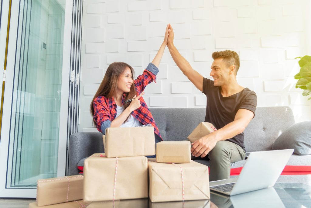 young couple working at home subscription payments