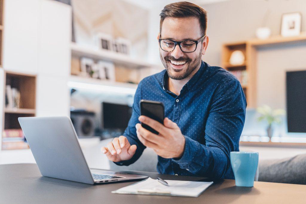 Man using smart phone at home subscription company
